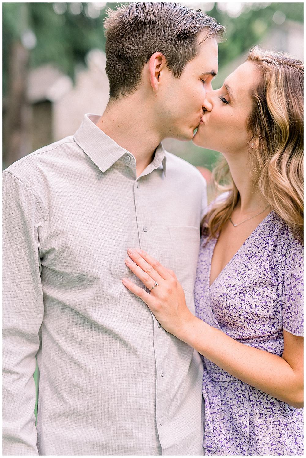 An engaged couple kissing at Historic Shady Lane