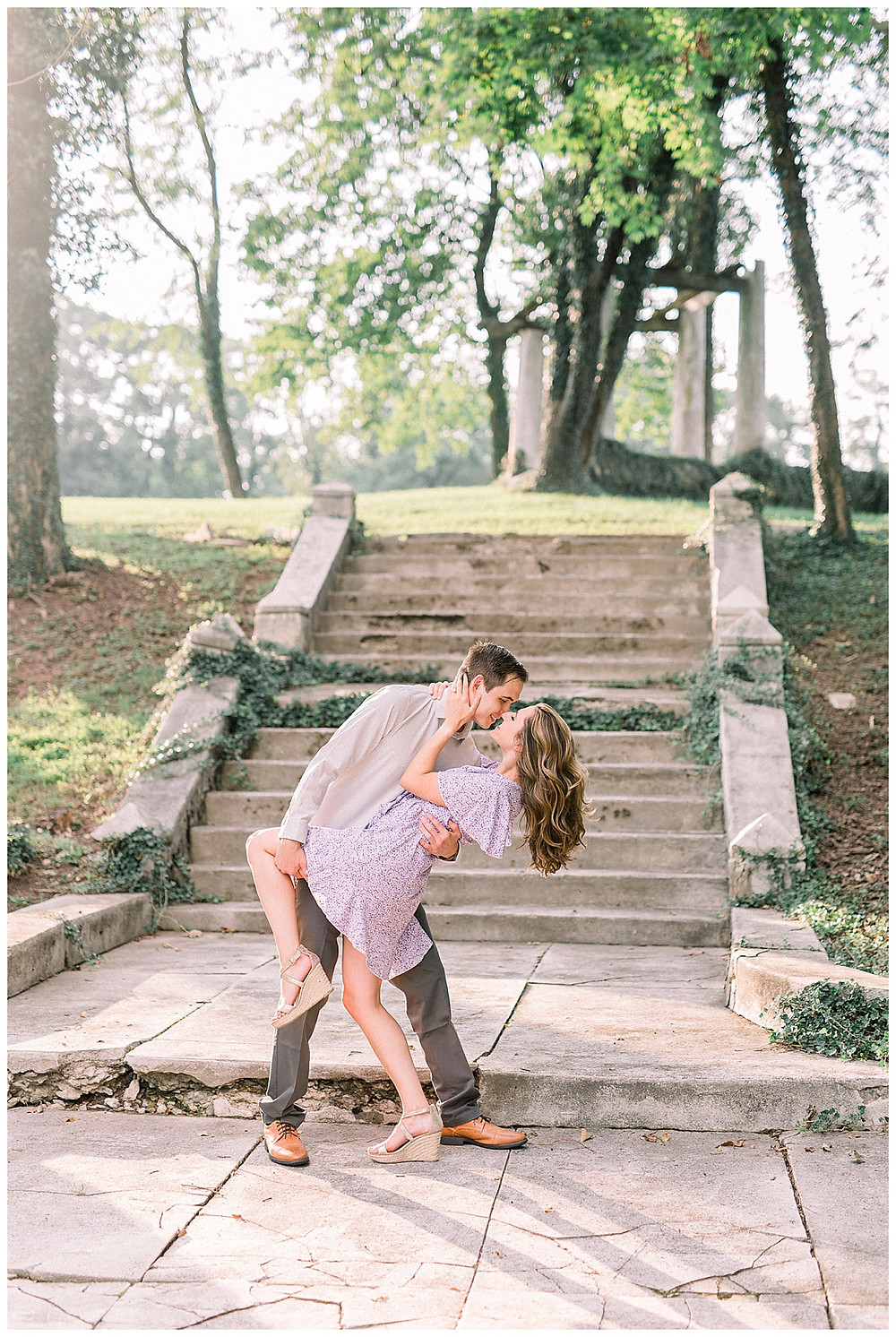 A man dipping his fiancé at Historic Shady Lane