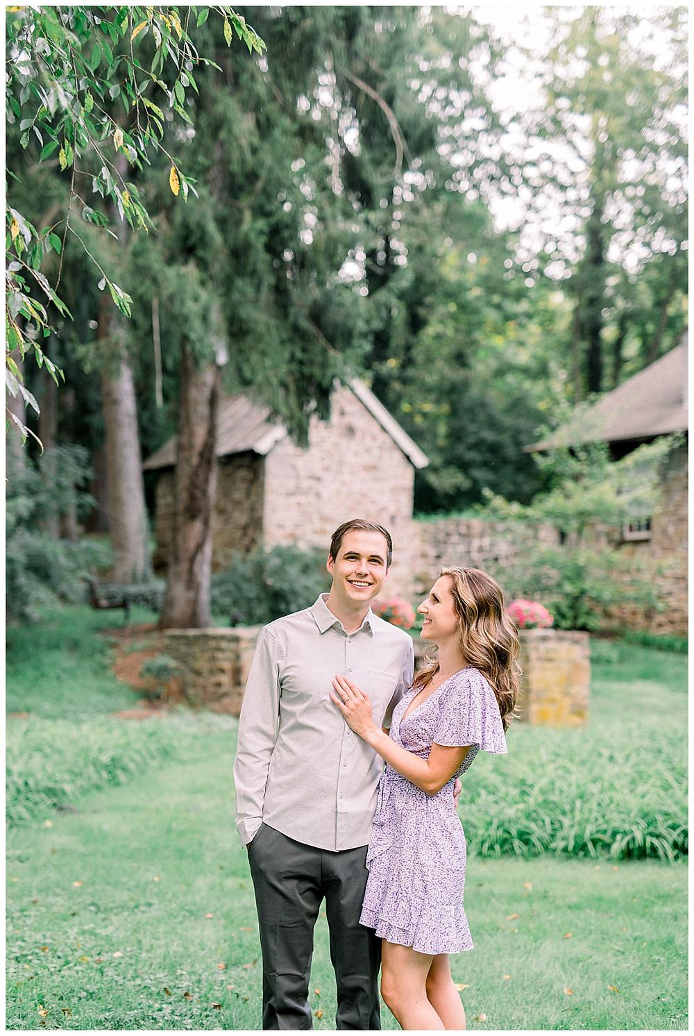Happy engaged couple posing at Historic Shady Lane