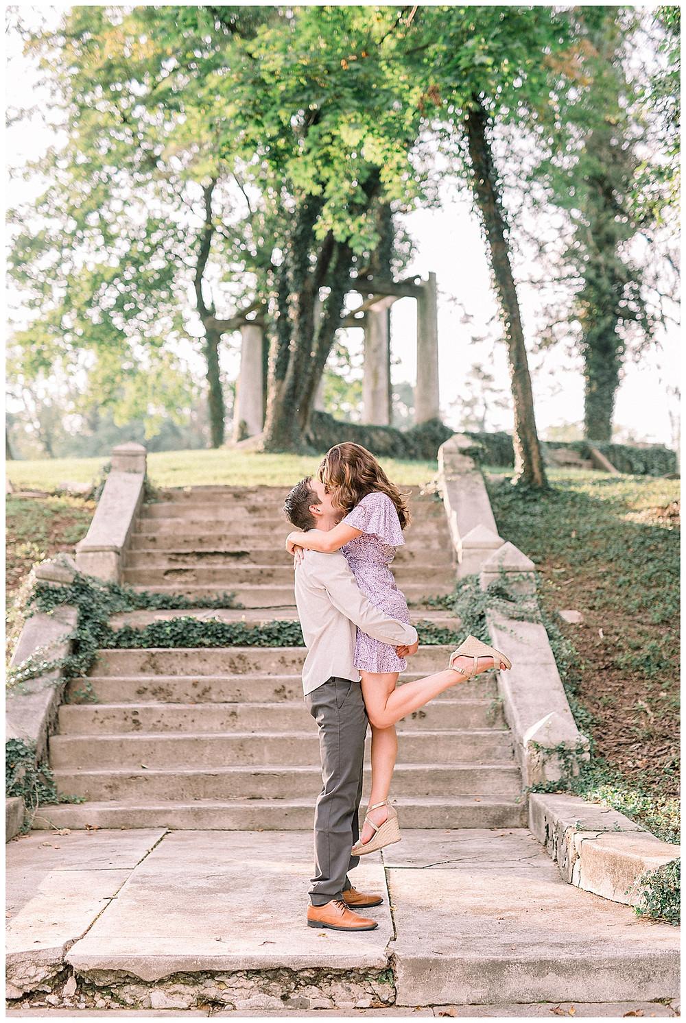 Engaged couple posing at Historic Shady Lane