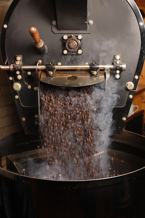 Freshly Roasted Espresso beans coming out of the roaster