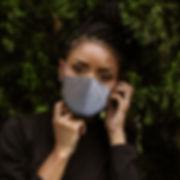 woman_in_Mask_standing-near-plants-32870