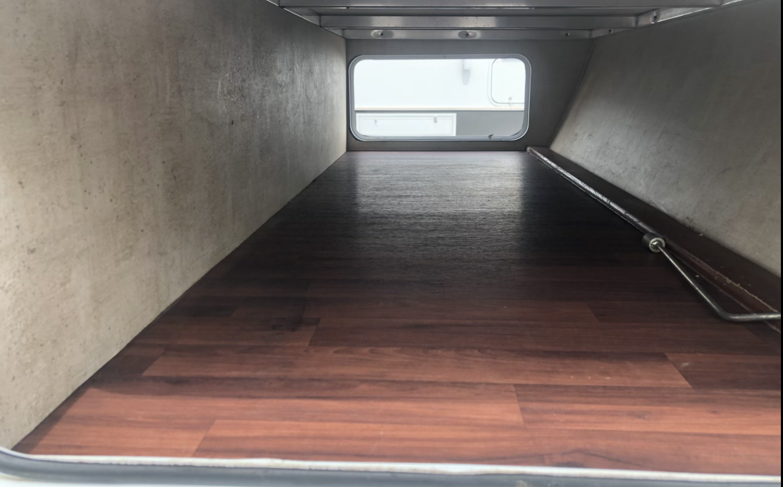 Pass Through Storage Compartment