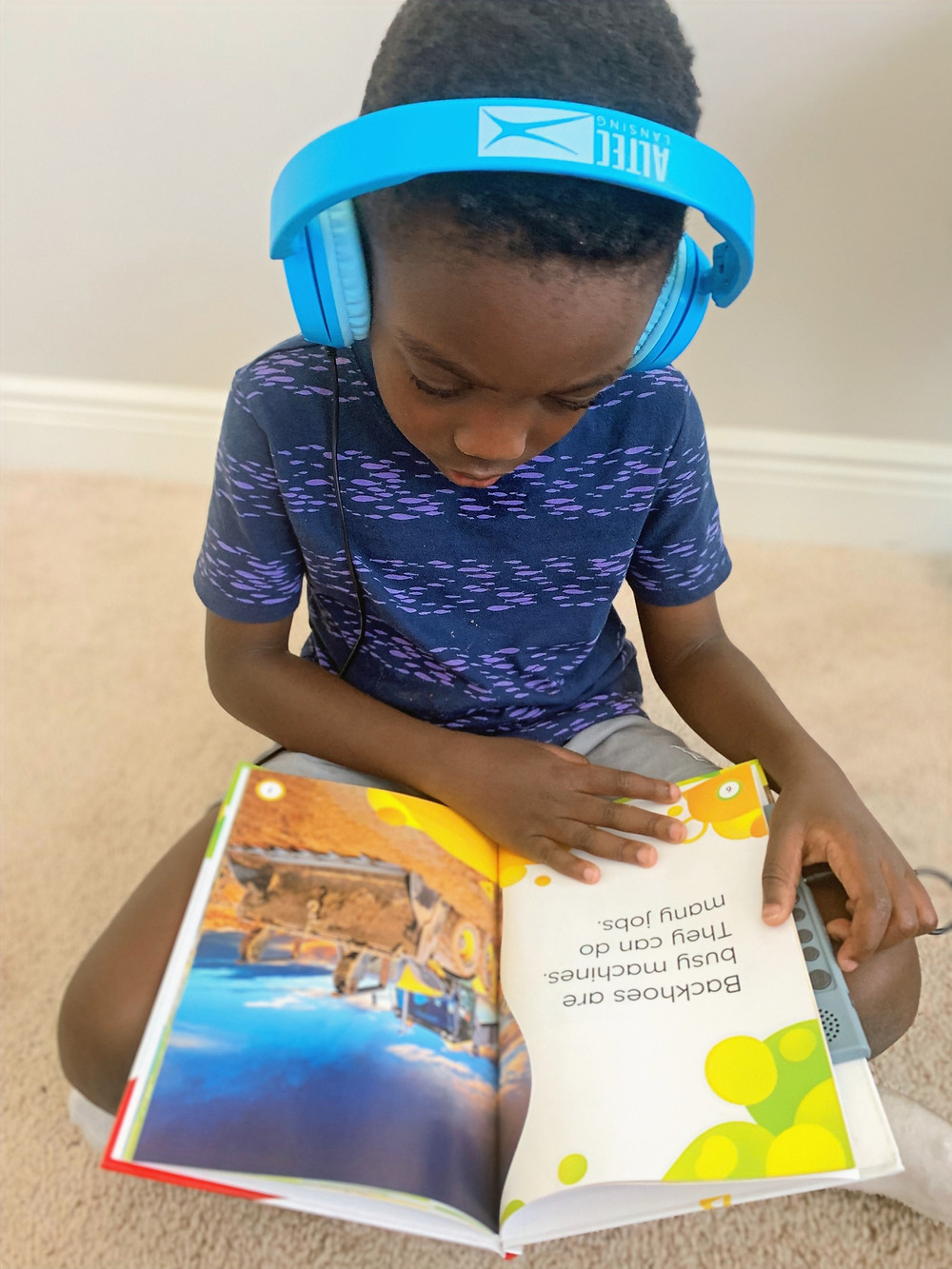 A boy listening to a vox book being read