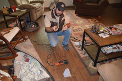 Todd completing flooring repairs