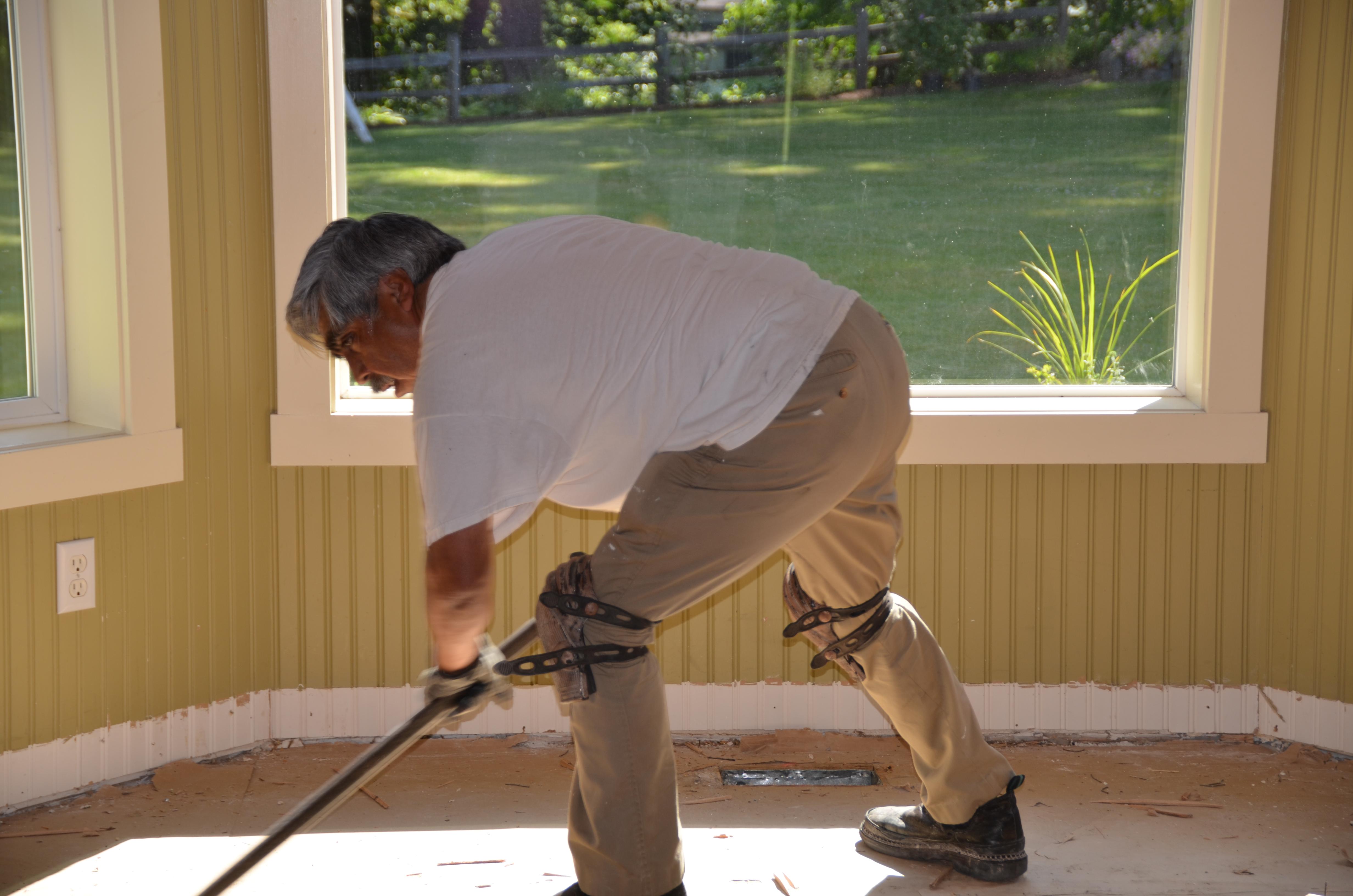 Francisco removing damaged flooring