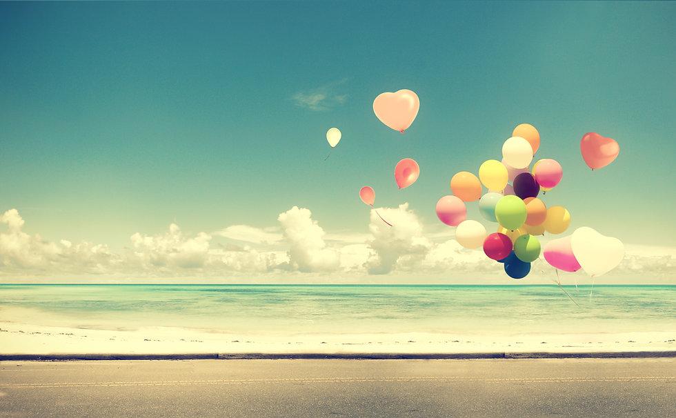 Vintage heart balloon on beach blue sky