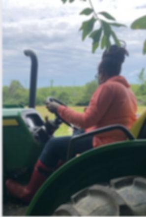 Trina on the tractor.jpg