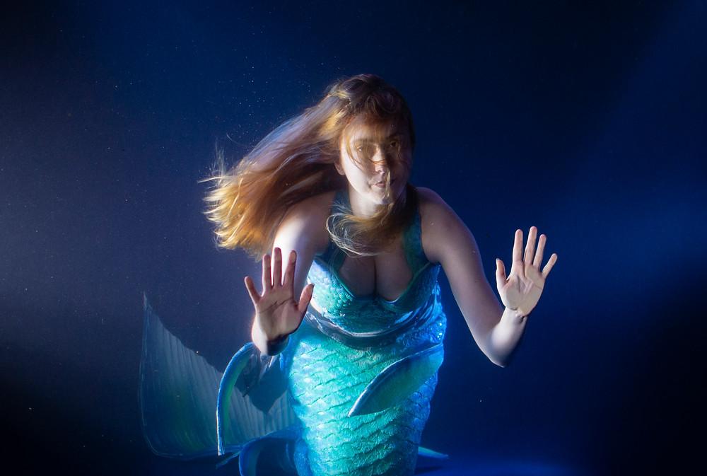 real mermaid in a mermaid tank