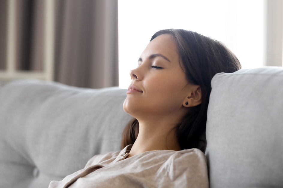 Serene calm woman relaxing leaning on co