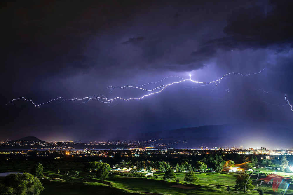 Lightning flashing over Okanagan Lake in Kelowna, BC.
