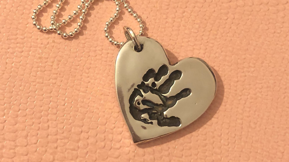 handprint silver necklace
