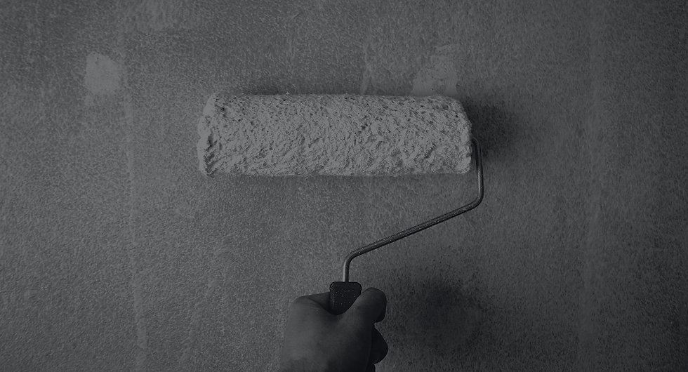 person-holding-paint-roller-on-wall-1669