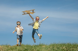 photodune-20147269-little-kids-playing-with-cardboard-toy-airplane-in-the-park-at-t-xxl