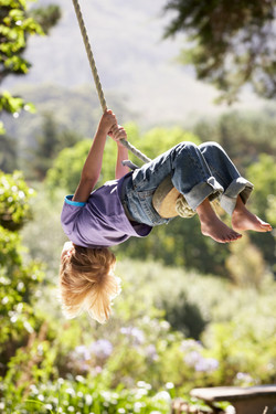 photodune-12456718-young-boy-having-fun-on-rope-swing-xl