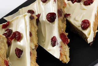 Our snowy white chocolate and cranberry tiffin is the perfect cake for your winter wonderland!