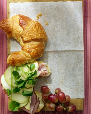 Add some indulgence to your breakfast menu by introducing ham and cheese croissants dressed with fru