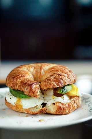 Poached Eggs and Avocado on a Croissant