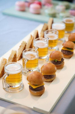 Spoil your customers with mini burger sliders served as a canapés and mini beers this festive season