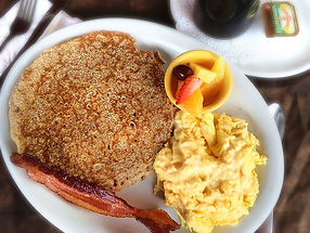 Buttermilk pancake with bacon, scrambled eggs, and fresh fruit