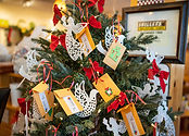 Christmas tree with envelopes for cash donations to charity