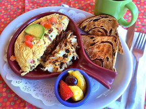 Skillet Omelet with tomato, siss cheese,avocado, toast and fruit