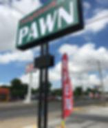 neighborhood pawn outside sign