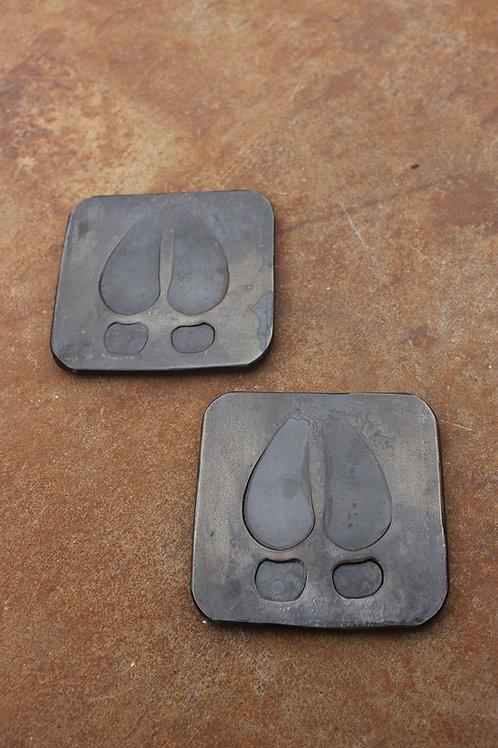 A Pair of Hoof Print Coasters