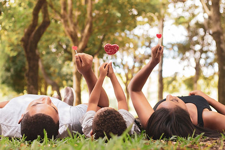 Canva - People Lying on thre Grass Holdi