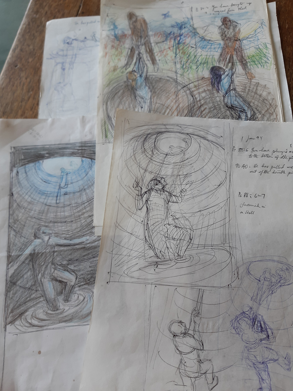 A selection of sketches of ideas for Jeremiah down the well, dated 1994, 2008, 2020. Some are biro, some are pencilled in colour, pose varies slightly between being at the bottom of the well, to being at the mouth being pulled out