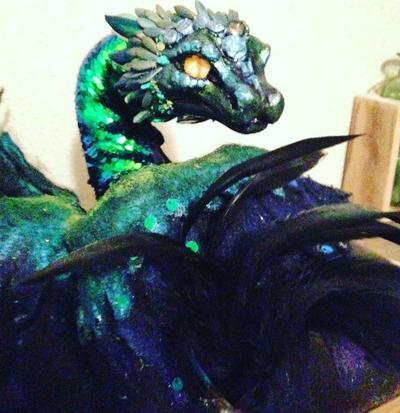 quetzalcoatl_shoulder_wyrm__sold___by_ro