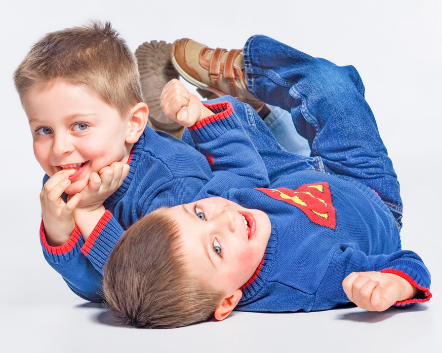 Two brothers on the floor playing