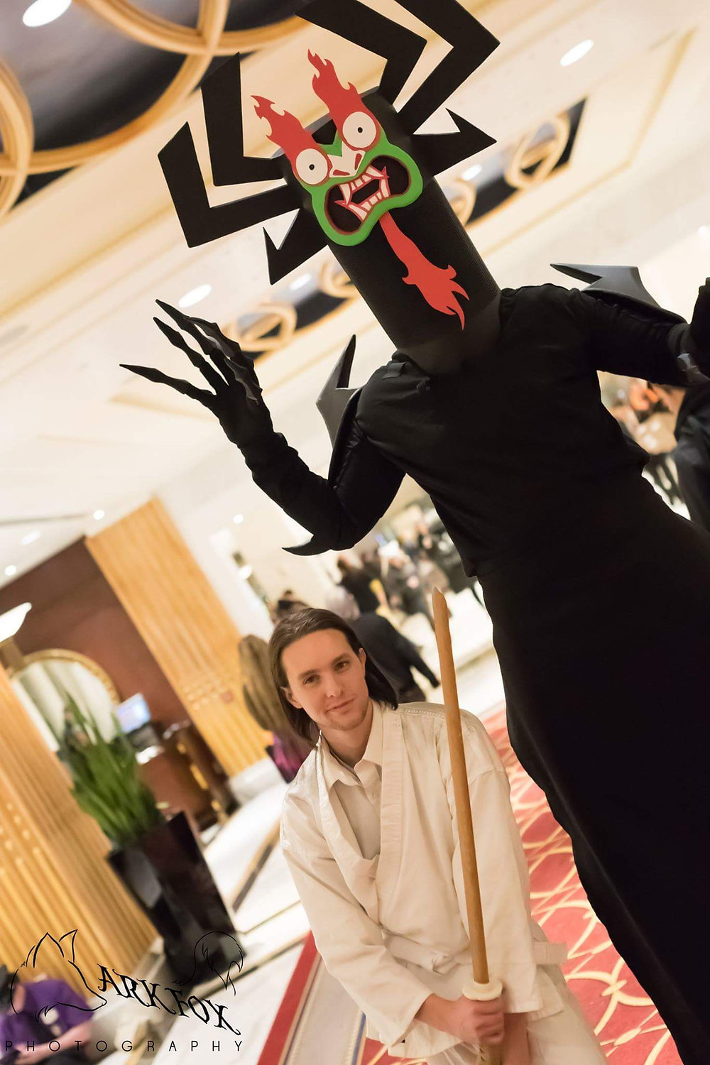 Two men in cosplay, one is aku from Samurai Jack and the other is Samurai Jack