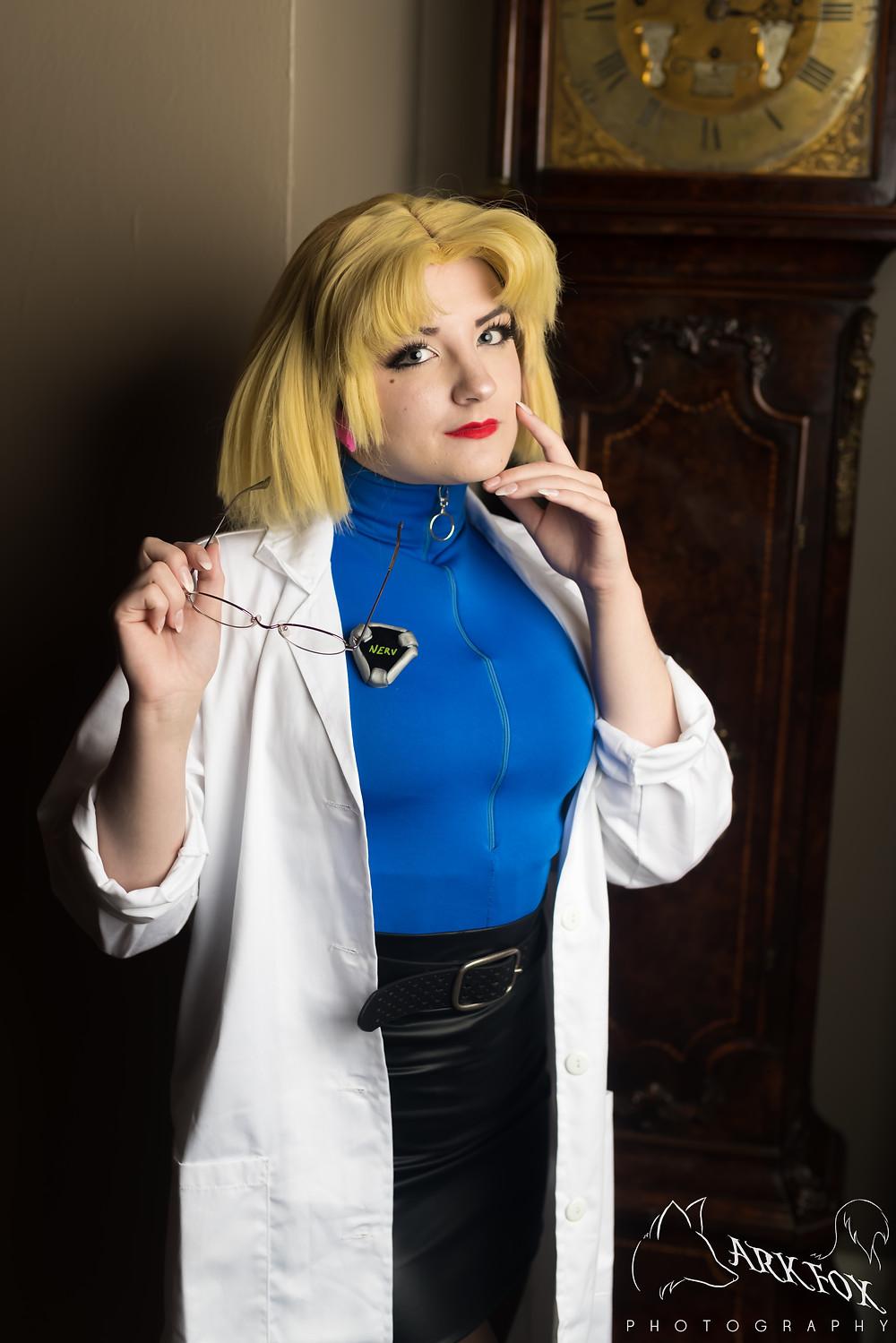 Ritsuko cosplayer from Evangelion posing in front of a benjamin clock