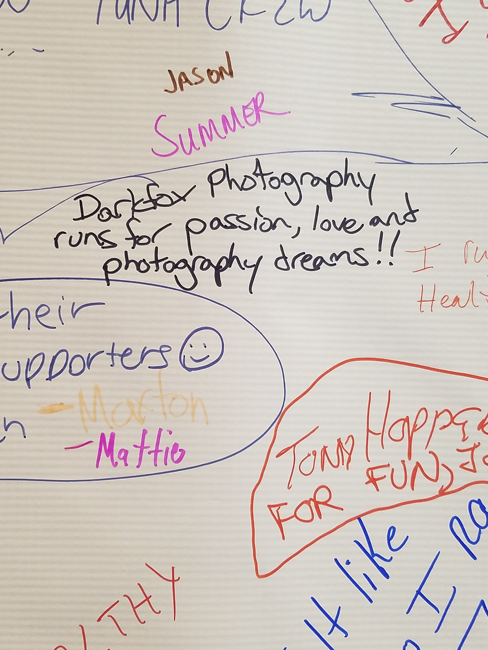An inspirational board for marathon runners detailing various reasons why they run