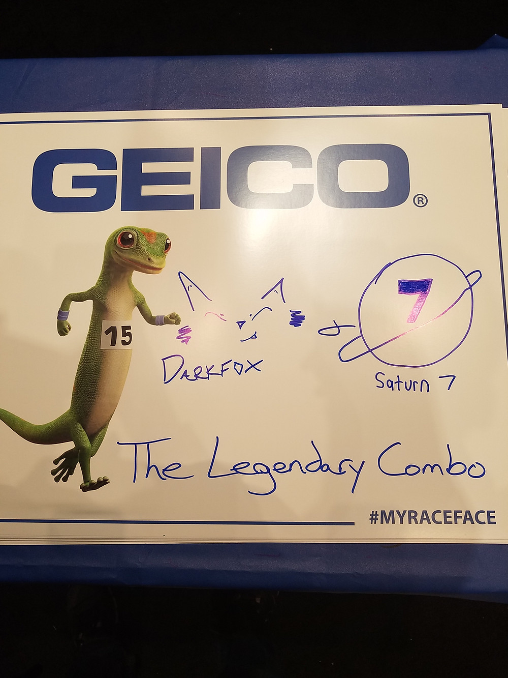 The Geico Gecko running in a marathon alongside images of Darkfox Photography's Logo and the logo for Saturn 7 Photography