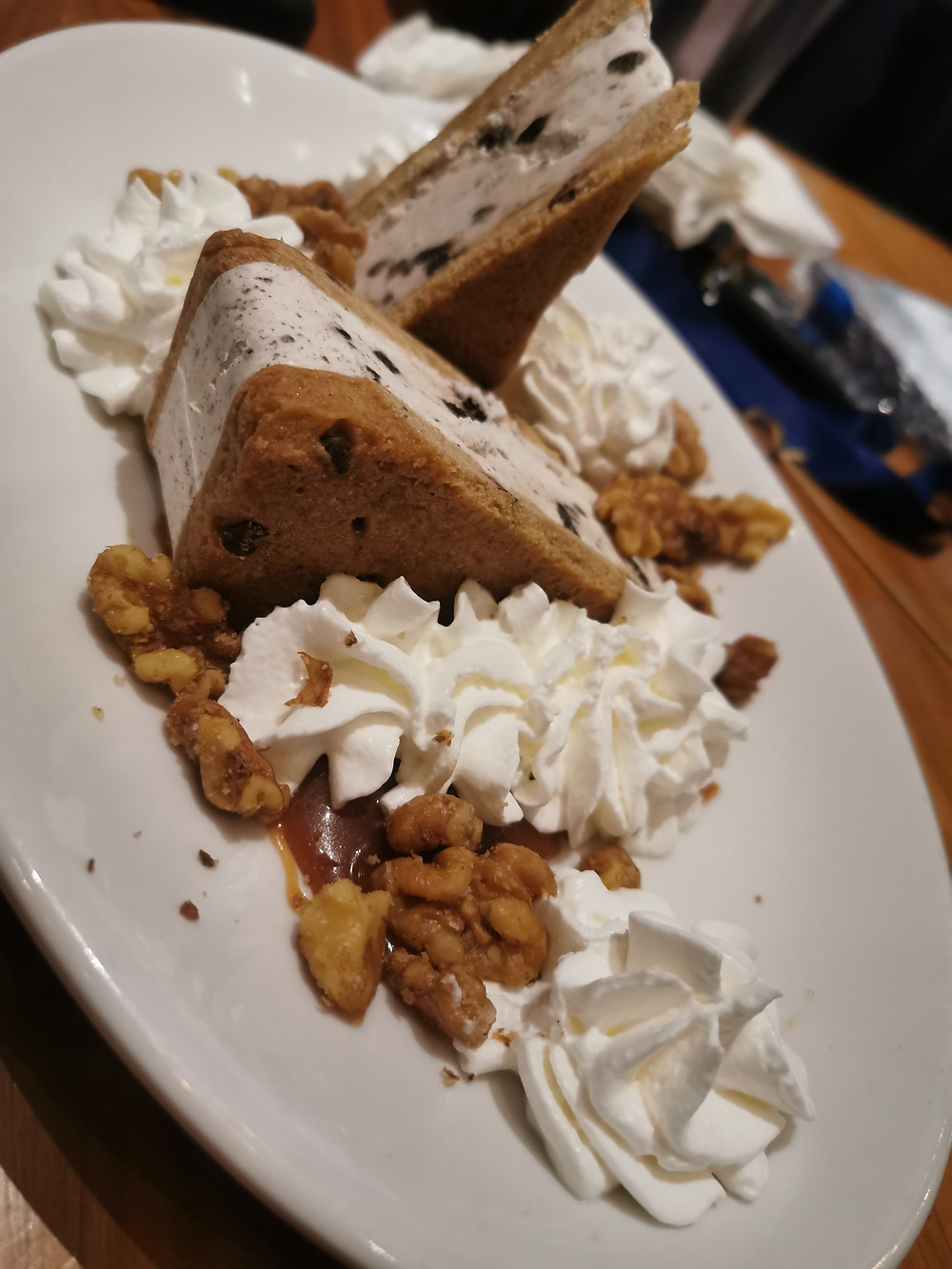 A chocolate cookie ice cream sandwich in pie slice form