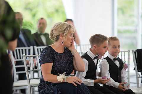 mother of bride sheds tear during wedding ceremony