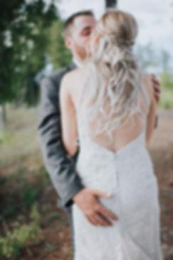 groom grabbing bride butt