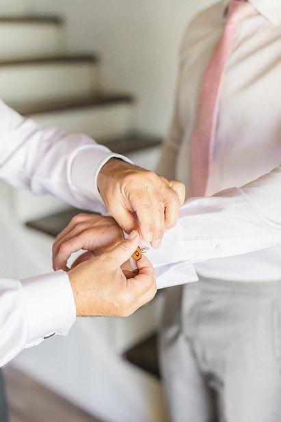 Ottawa Wedding Photography Groom putting cuffling