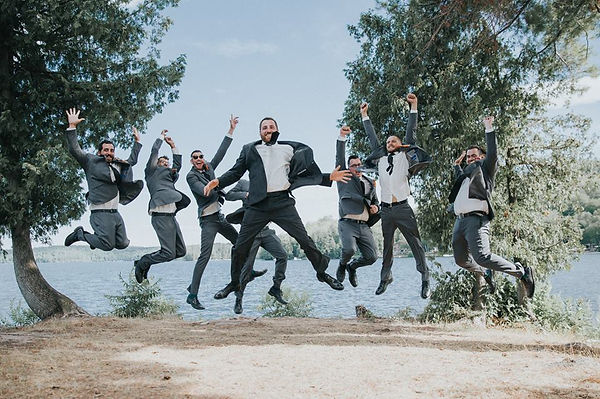 groom and groomsmen photography by the water