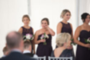 Bridesmaid sheds tear during wedding ceremony