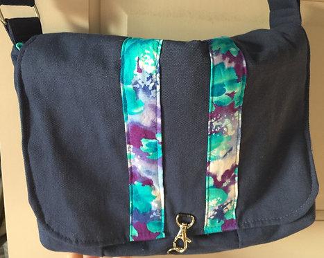 Navy blue/floral print messenger bag
