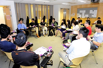 Group discussion in tutorial room.png