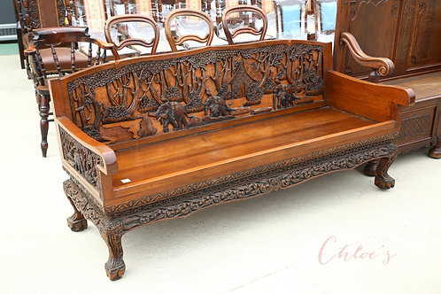 Carved bench with cushions