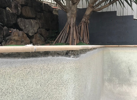 Pebblecrete cracked under pool coping with loose coping