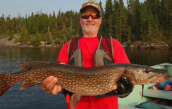 Mike Cowden Holding a 3 foot long northern pike