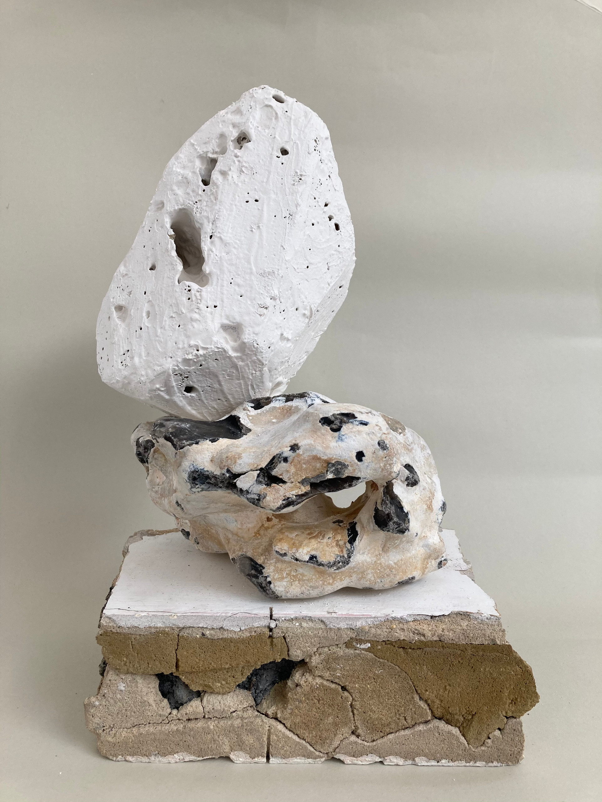 Stacking Stones, a concrete and plaster slab, a flint stone, a foam and plaster rock. Dimensions variable. 2021
