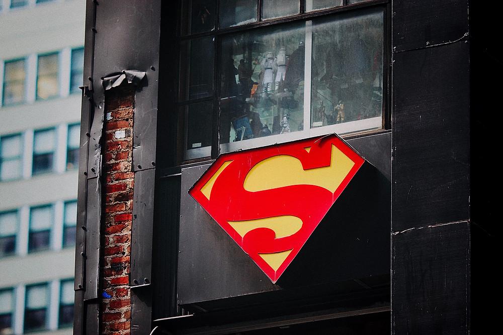 Superman logo on outside of window.