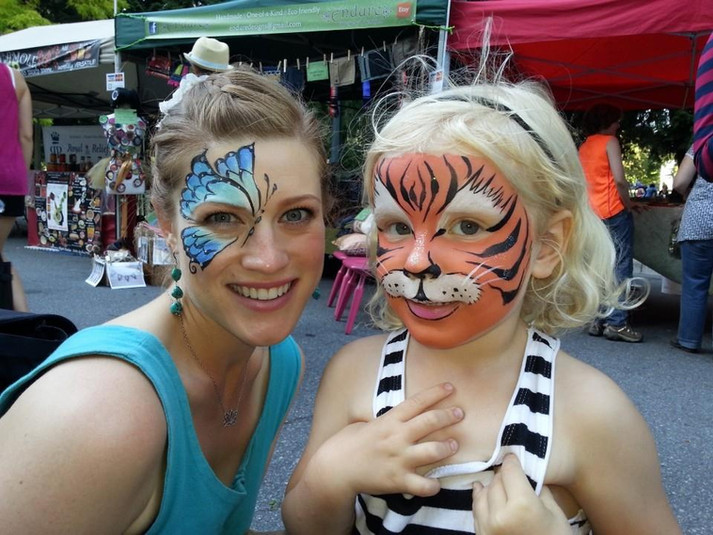 Allyson and a cute tiger hanging out at the New Westminster Farmer's Market